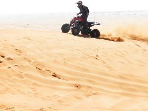 "DUBAI QUADBIKE ATV IN THE OPEN DESERT, SANDBOARDING, CAMEL RIDE, ""HOO-KKA"", BBQ DINNER, 03 LIVE SHOWS AT ""MAJILIS"" CAMP"